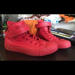 All red converse with Velcro strap